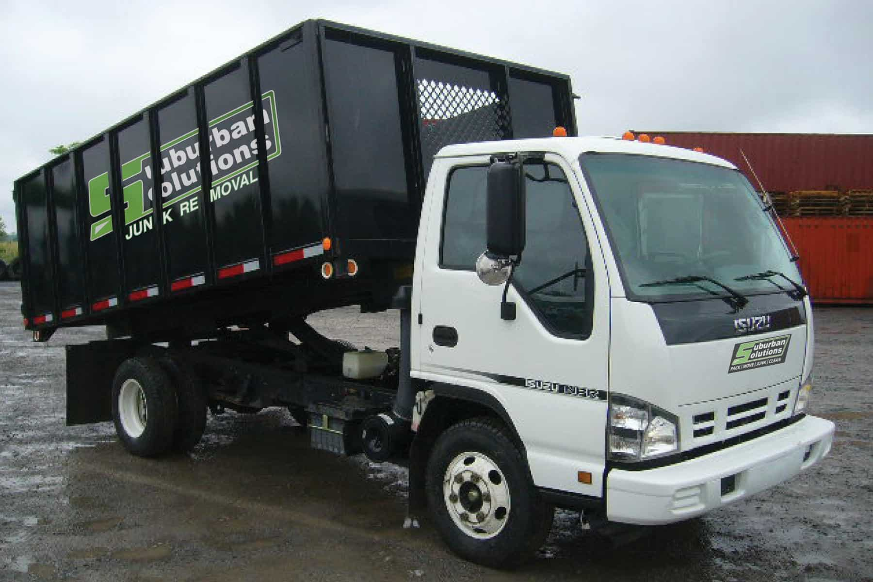 Suburban Solutions' dump truck unloading junk we've collected