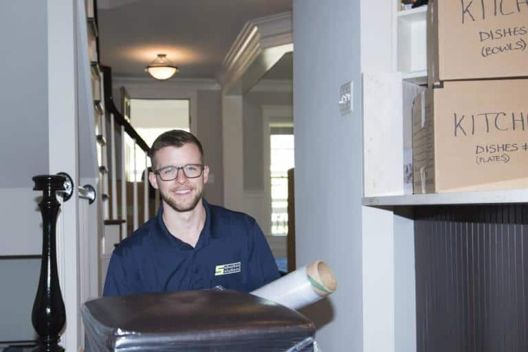 A member of our Suburban Solutions' moving crew taking out some of your stuff