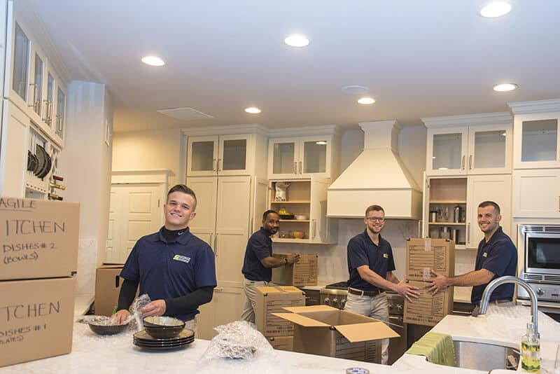 Suburban Solution's crew unpacking kitchen essentials