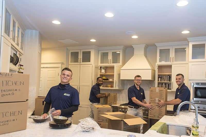 Suburban Solution's crew unpacking kitchen essentials