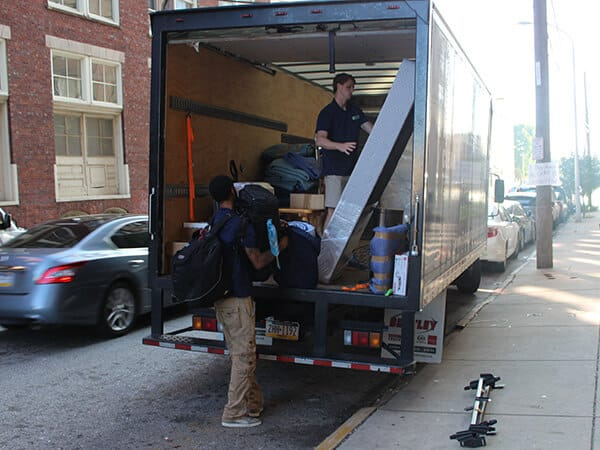 Suburban Solutions' highly trained staff loading one of the junk trucks
