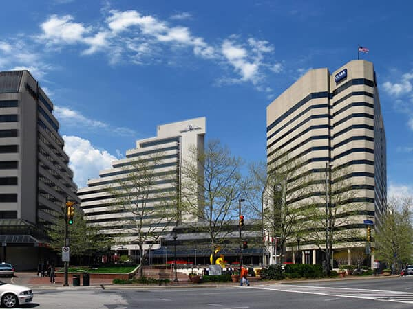 The intersection of Maryland Route 187 (Old Georgetown Road), Maryland Route 355 (Wisconsin Avenue), and Maryland Route 410 (East West Highway), near the Bethesda Metro station entrance, in downtown Bethesda