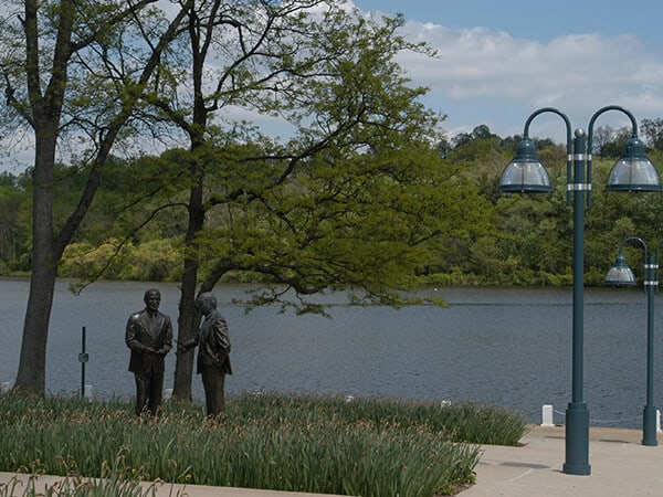 """Dealings"" statues of James W. Rouse and his brother, Willard, at Lake Kittamaqundi"