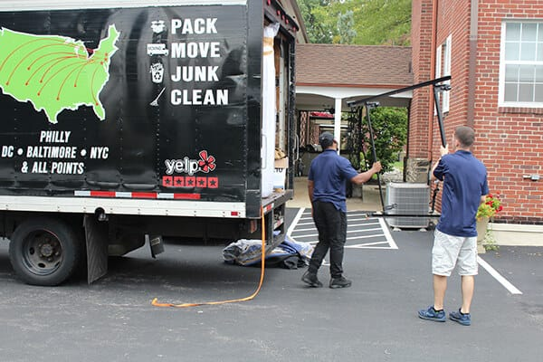 Suburban Solutions' junk disposal crew in action clearing your space of trash and unwanted items