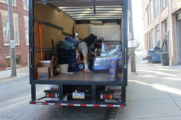 Suburban Solutions' crew loading our junk removal truck