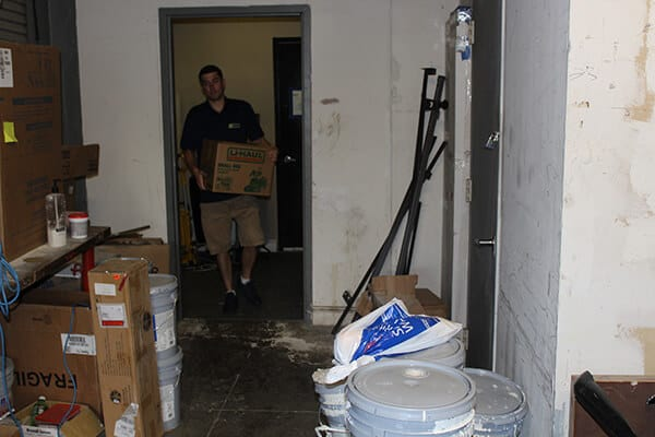 A member of Suburban Solutions' team taking out some unwanted junk