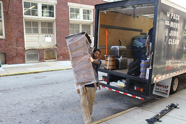 Suburban Solutions' moving team taking some of your stuff in your new home