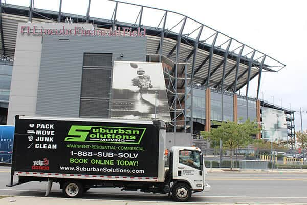 Suburban Solutions' moving truck waiting outside of Lincoln Financial Field - a home of Philadelphia Eagles and the Temple Owls football team of Temple University.