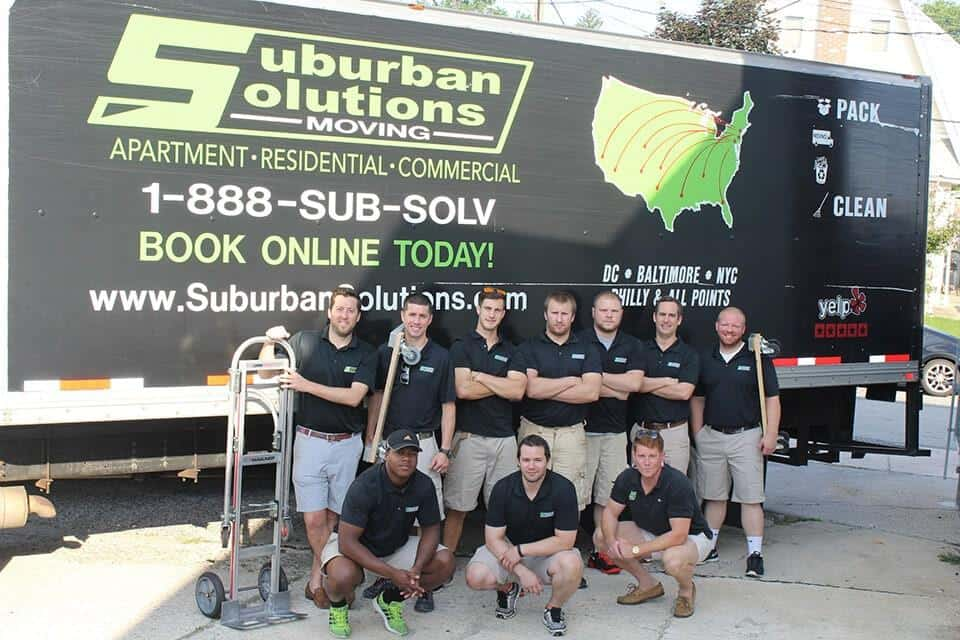 Philadelphia moving team posing in front of the truck