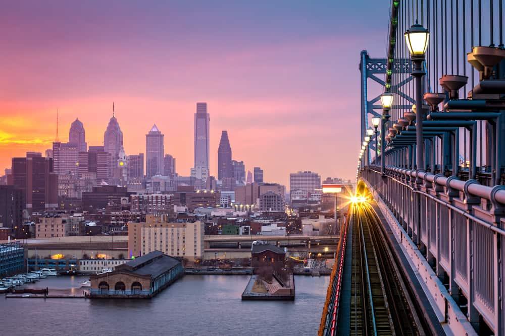 Train approaching on bridge across from Philadelphia